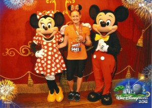 Kelly Akers, PT with Mickey and Minnie after the Walt Disney Marathon